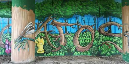 Mural de graffiti ao carón do río Gafos
